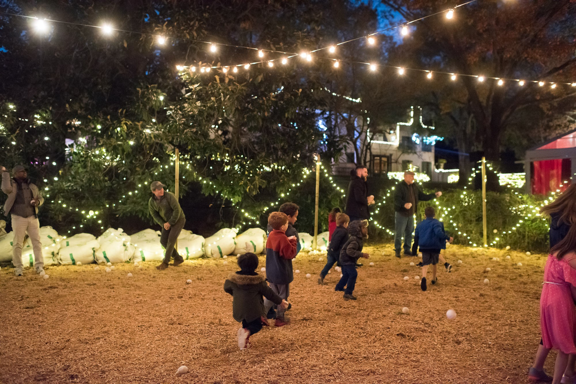 Faux-snowball toss at Christmas Village at Bayou Bend