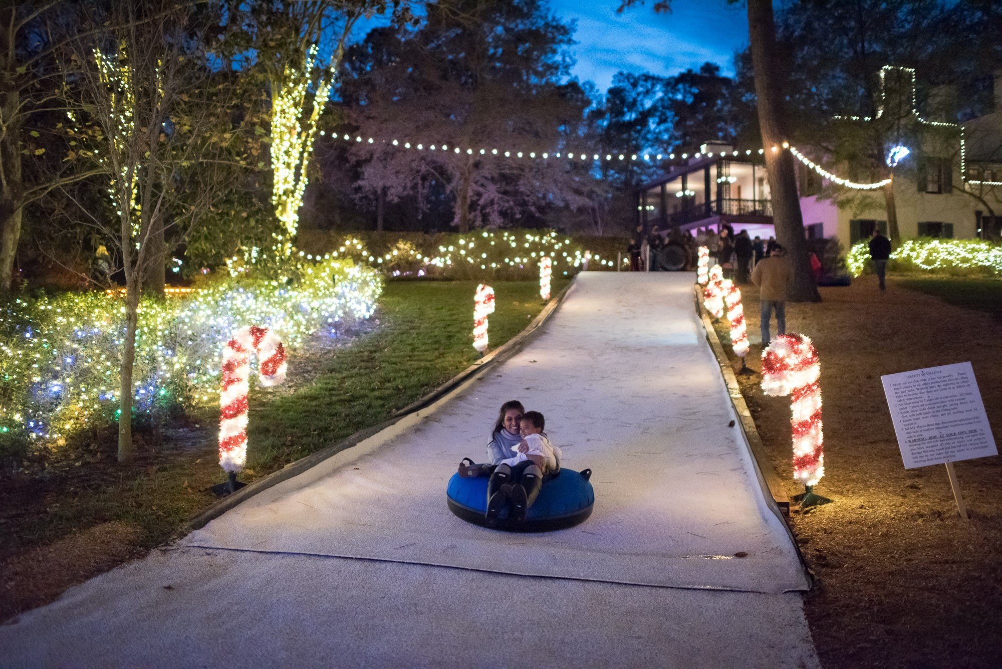 Faux-snow sledding at Christmas Village Bayou Bend