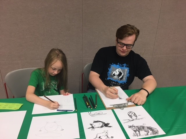 Bella and Will Irwin, drawing together