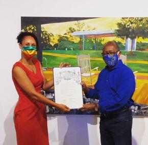 "Melissa Aytenfisu and Mayor Sylvester Turner at her ""Metamorphosis"" exhibition."