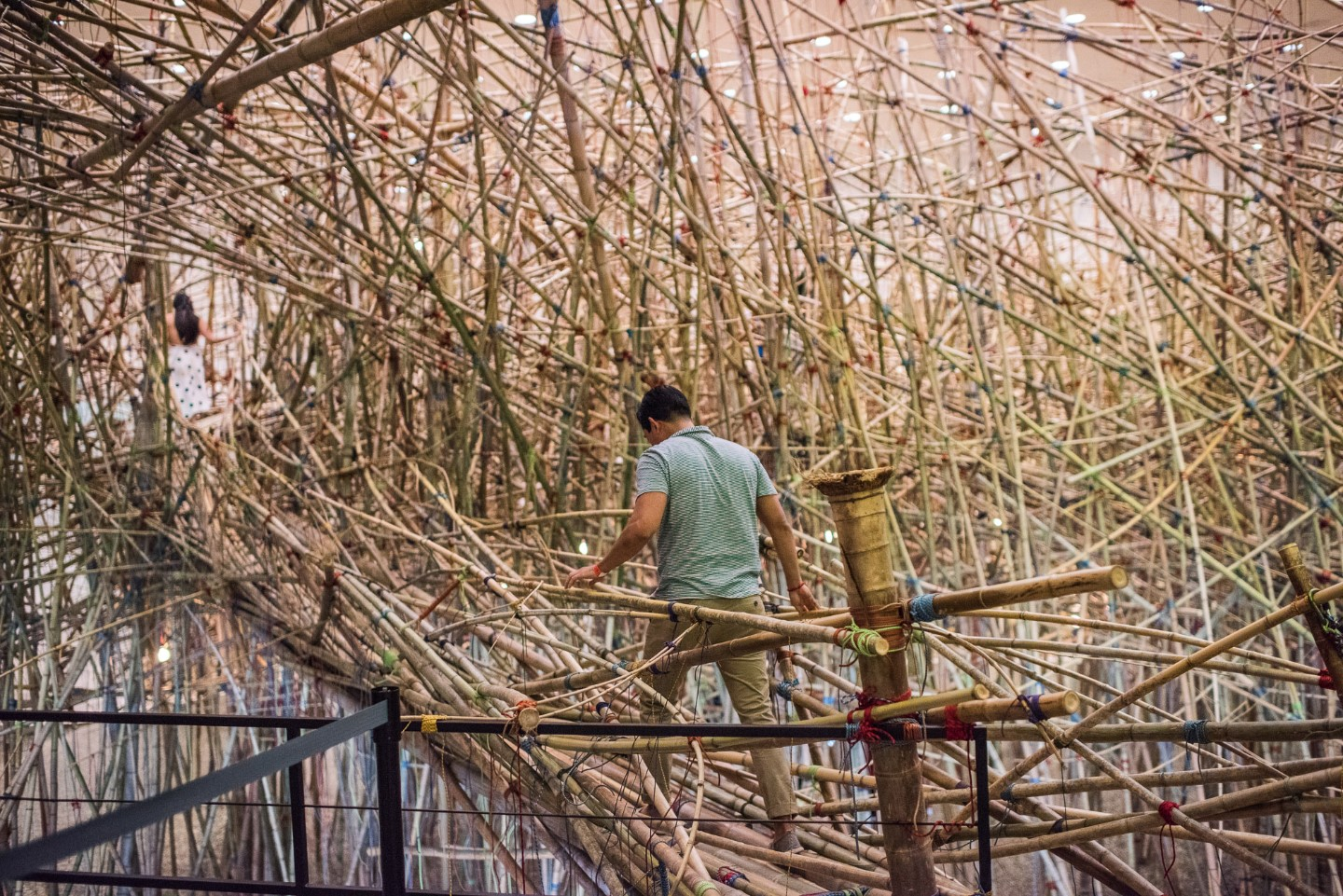 Mike + Doug Starn: Big Bambú - adult on bridge into pathway