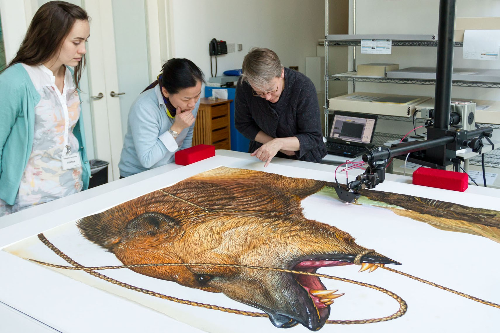 Left to right: Advanced conservation intern Heather Brown, works on paper conservator Tina Tan, and research scientist Cory Rogge discuss the artist's palette.