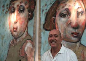 Patrick Palmer headshot w/paintings