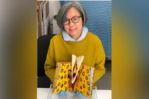 Tina Tan, conservator, works on paper